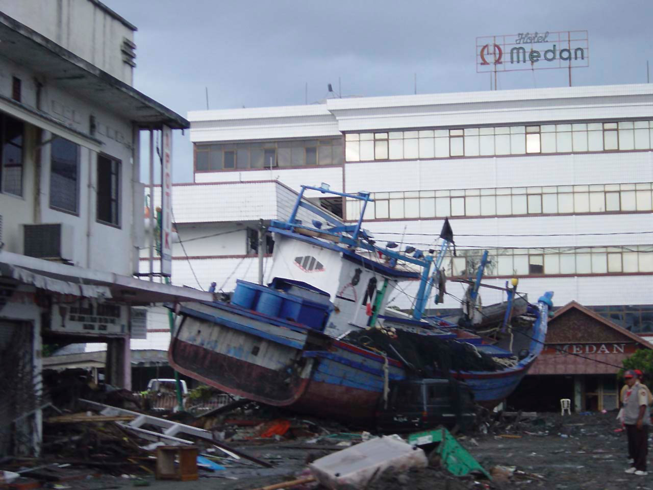 Boats washed ashore near local businesses in down town Aceh, Sumatra following a massive Tsunami