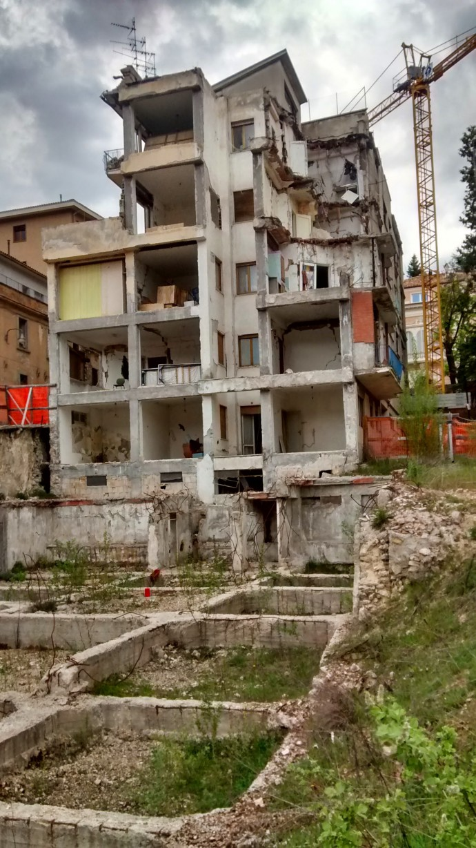 One of the collapsed multi-storey houses.