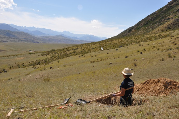 Digging sampling pits, note the helikite in the background.