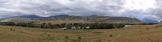 A panorama of Saty, with the Chilik river in the foreground.